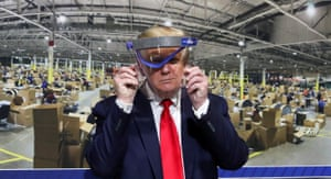 Donald Trump holds up a protective face shield during a tour of the Ford Rawsonville plant, in Michigan. The president said he did not want to give the press 'the pleasure' of seeing him in a mask