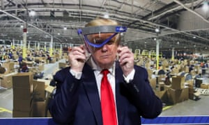 US President Trump visits Ford Rawsonville Components Plant in Ypsilanti, Michiganand holds up a protective face shield during a tour of the plant on May 21, 2020. REUTERS/Leah Millis TPX IMAGES OF THE DAY