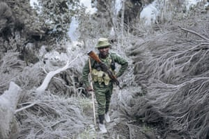 A ranger from the Virunga national park climbs the slopes of the Nyiragongo volcano.