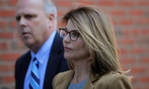 Lori Loughlin is accompanied to federal court in Boston, Massachusetts on 3 April.