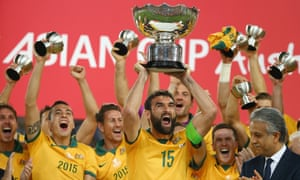 Mile Jedinak and his team celebrate as he lifts the trophy after victory during the 2015 Asian Cup final match between Korea Republic and the Socceroos.