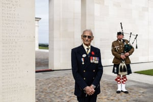 Veteran David Mylchreest, 97, poses next to the lone piper Jerome Levannier during the official opening ceremony of the British Normandy memorial at Ver-sur-Mer