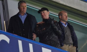 Chelsea's new interim manager Guus Hiddink, left, and Chelsea's owner Roman Abramovich, right, leave after the final whistle.