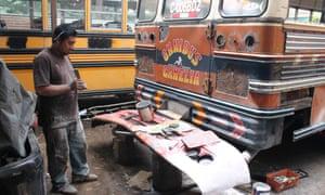 Mechanics refurbishing buses in Ciudad Vieja.