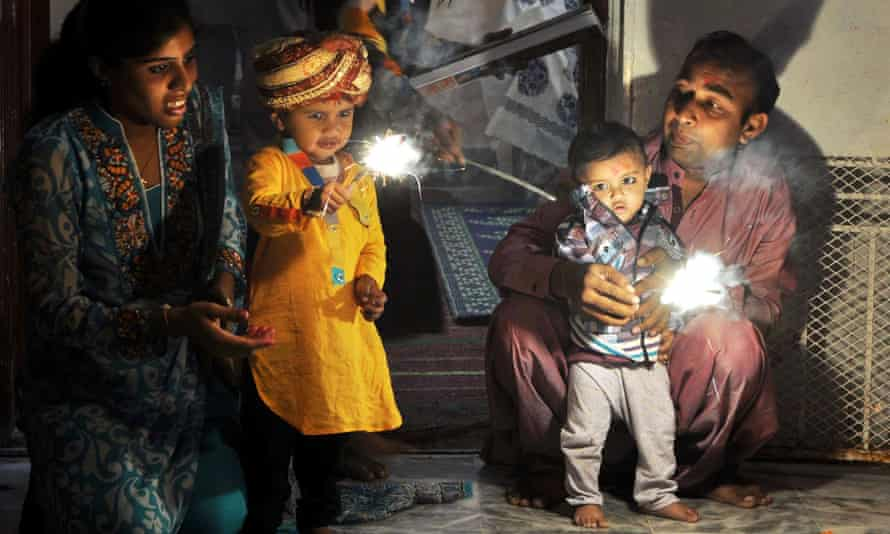 Pakistani Hindus celebrate Diwali with traditional sparklers in Karachi.