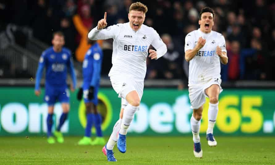 Swansea City's Alfie Mawson celebrates scoring the opening goal against Leicester City, with Jack Cork running to congratulate him.