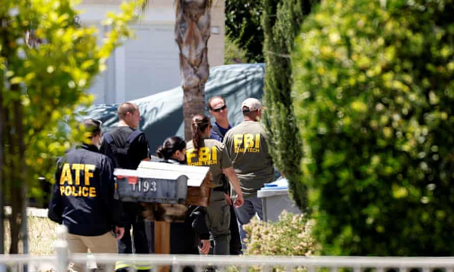 ATF and FBI agents approach the scene of the Santa Clara Valley Transportation Authority mass shooting suspect's house.