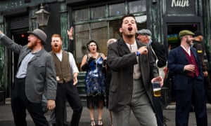 Actors recreate scenes from the show on the streets of Digbeth.