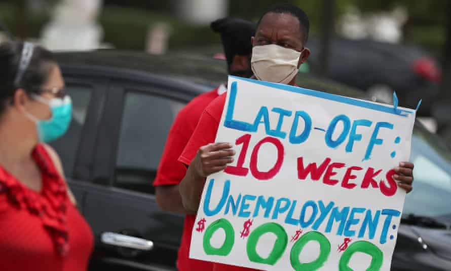 Joseph Louis joins others in a protest asking the state of Florida to fix its unemployment system on 22 May in Miami Beach. Many states are still processing a huge backlog of claims.