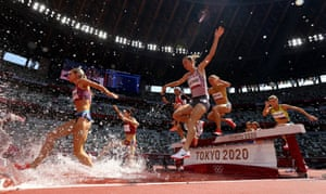 Emma Coburn of the United States and Genevieve Lalonde of Canada in action during their women's 3,000m steeplechase heat.