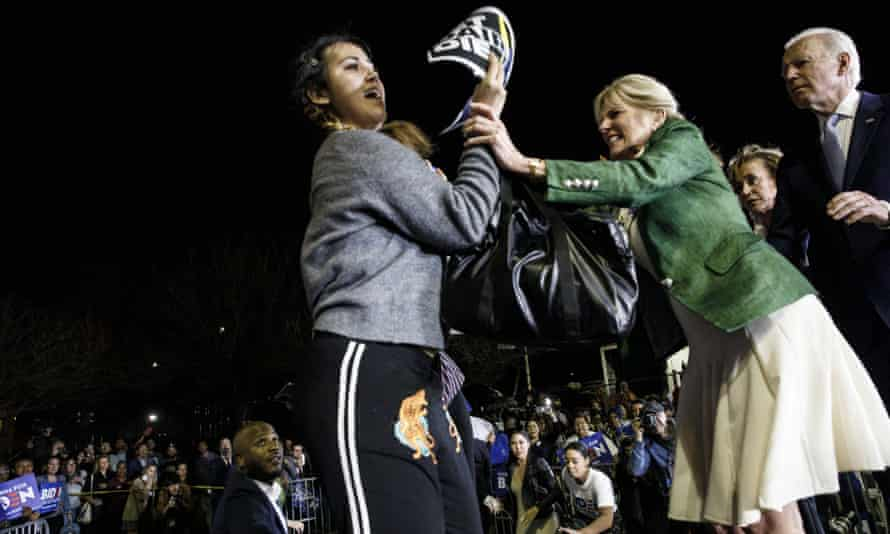 Jill Biden, center, blocks a protester from arriving on stage during a primary night rally in Los Angeles, California, on Super Tuesday.