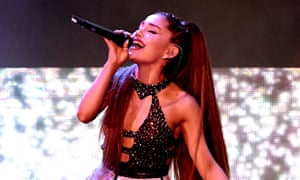 Ariana Grande performing onstage in 2018