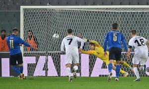 Italy's Vincenzo Grifo (left) slots home a penalty kick