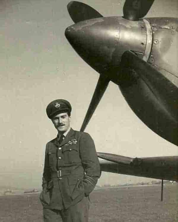 Paul Farnes in uniform in front of plane's propeller
