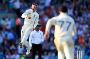 England's Joe Root celebrates taking the wicket of Australia's Matthew Wade.