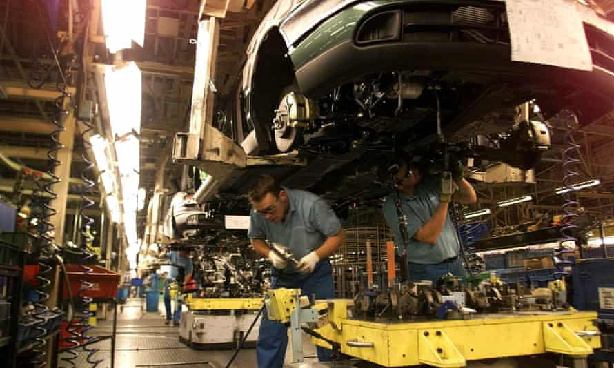 car workers on the production line