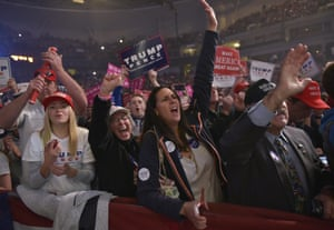 Supporters cheer as Republican presidential nominee Donald Trump addresses the final rally of his 2016 presidential campaign at Devos Place in Grand Rapids, Michigan on November 7, 2016.