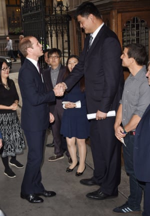 Prince William, left, meets retired Chinese basketball player Yao Ming, and explorer Bear Grylls prior to delivering a speech on the illegal wildlife Trade For Chinese Television, at King's College, in London