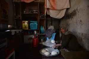 Mahgul prepares dough to make bread
