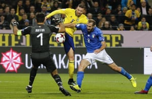 Gianluigi Buffon is out to prevent Marcus Berg from scoring.
