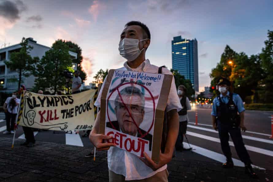 A protester holds a placard with a picture of Thomas Bach during a demonstration against the Games, earlier this week.