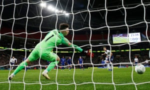 Tottenham's Harry Kane scores their first goal from the penalty spot.