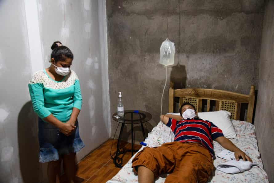 Neraldo Jardiel Cantillano Carrero, 30, a former sugar cane worker for only 2 years, receives dialysis at home. He has been sick for 10 years and been on dialysis 3 months, and is seen here with his wife, Norma Elena Ortiz Melendez.