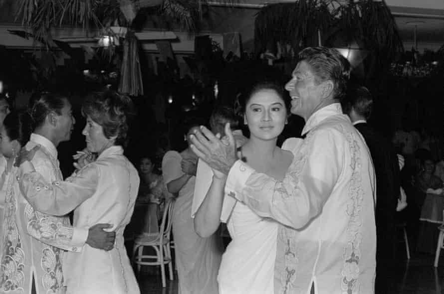 Ronald Reagan dances with Imelda Marcos, while President Marcos dances with Nancy Reagan, during a state visit to Manila in 1969.