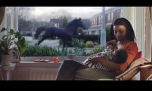 An image from a Lloyds Bank advert which features a black horse.