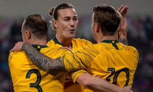 Adam Taggart, right, celebrates his goal with Brad Smith and Jackson Irvine.