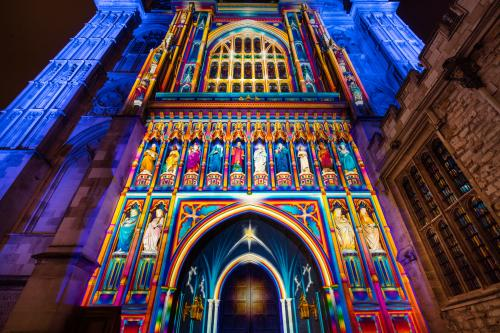 London, England: A projection of light and colour illuminates the facade of Westminster Abbey