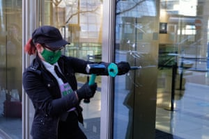 Handout photo issued by Extinction Rebellion of their protest at Barclays in Canary Wharf, London, where they used hammers and chisels to break windows.