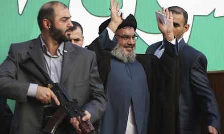 Hezbollah leader Sheik Hassan Nasrallah, flanked by armed bodyguards