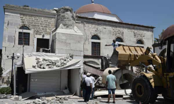 Workers remove rubble from a quake-damaged mosque in Kos