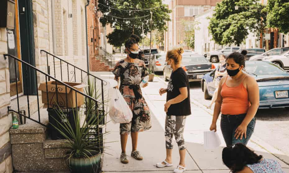 Baltimore HeatTehma Smith Wilson of The Door, a resiliancy hub in Baltimore distributes food and water to residents on June 24, 2021.
