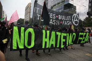 Antifa, opponents of white nationalist, holds banners during a rally, marking the one year anniversary of the 2017 Charlottesville 'Unite the Right' protests.