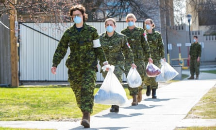 Members of the Canadian armed forces are seen outside the Eatonville Care Center in Toronto, Canada, last month.