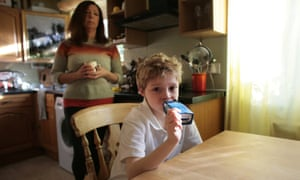 Christine Walker with her son, Louis, who has cystic fibrosis that clogs the lungs and uses a nebulizer to help him breathe.