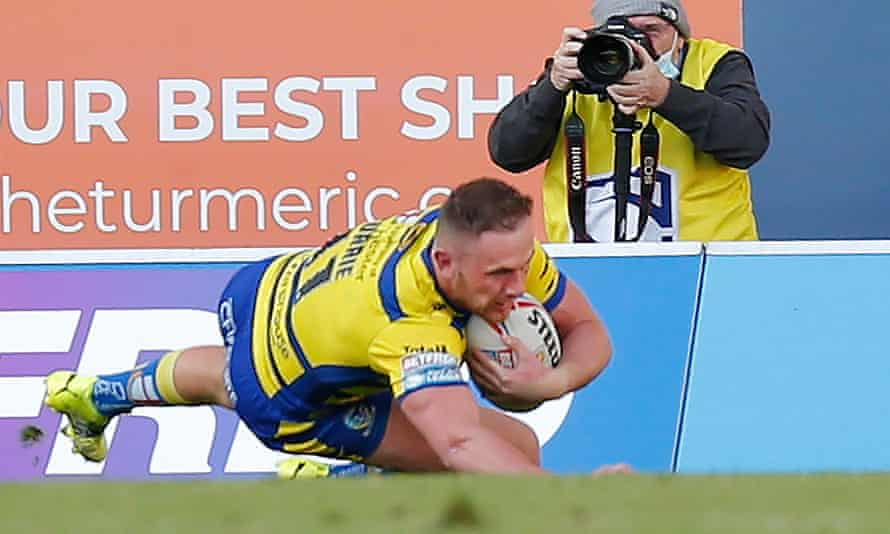 Ben Currie of Warrington goes over for the only try of the match at St Helens.