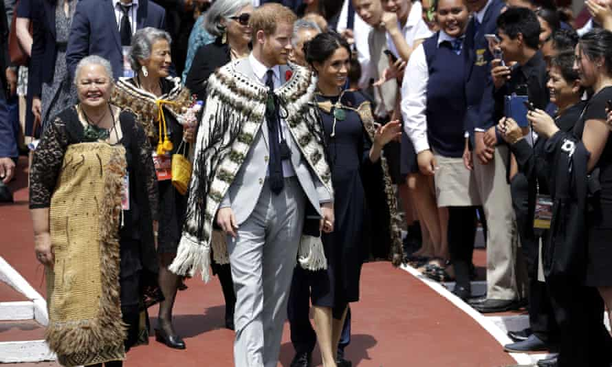 FILE - In this Oct. 31, 2018 file photo, Britain's Prince Harry and Meghan, Duchess of Sussex greet members of the public during their visit to Te Papaiouru Marae in Rotorua, New Zealand. Prince Harry and his wife Meghan are ending their lives as senior members of Britain's royal family and starting an uncertain new chapter as international celebrities and charity patrons. In January the couple shocked Britain by announcing that they would step down from official duties, give up public funding, seek financial independence and swap the U.K. for North America. The split becomes official on March 31. (AP Photo/Kirsty Wigglesworth, file)