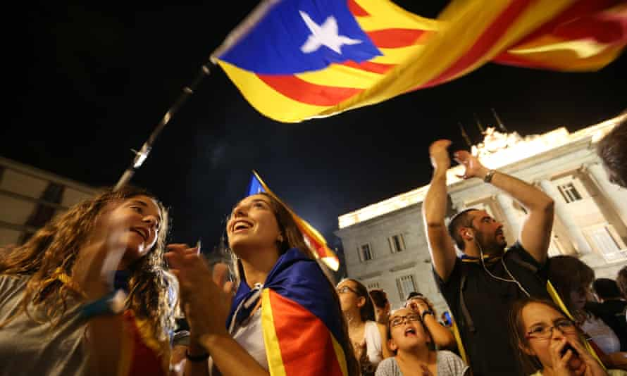 People waving Catalan independence flags in Barcelona last year.