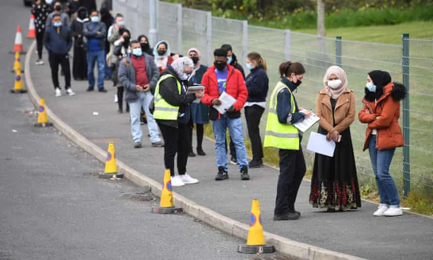 Queues for the Covid-19 vaccination at a temporary centre at the Essa academy in Bolton, where 'Indian variant' case numbers have spiked