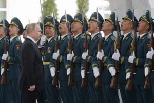 Bishkek, KyrgyzstanRussian President Vladimir Putin walks past the honor guards ahead of meeting with Kyrgyzstan President Sooronbay Jeenbekov in Bishkek, Kyrgyzstan, Thursday, March 28, 2019. (Maxim Shemetov/Pool Photo via AP)