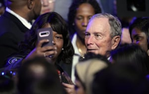 Mike Bloomberg poses for pictures with supporters at a campaign event in Houston.