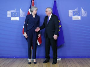 Jean-Claude Juncker extends his hand to May at the European commission headquarters in Brussels