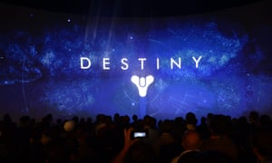 Attendees watch a presentation by Activision on its game 'Destiny' on the second day of the E3 (Electronic Entertainment Expo) in Los Angeles.