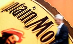 A pedestrian walks past an advert for Captain Morgan rum