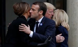 Macron kisses Melania on the cheek while Trump kisses Brigitte on the cheek.