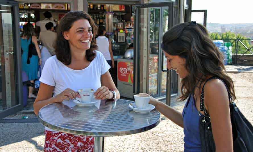Two women drinking coffee in Italy