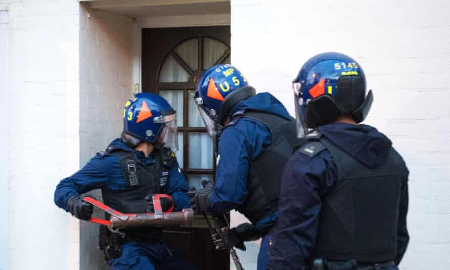 Police officers conducting a drugs raid in south London in 2018. The Sentencing Council's findings suggest a disparity in sentencing outcomes between BAME and white offenders.